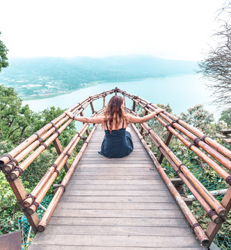 Girl sitting on the background of the lake, Bali