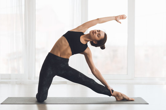 Relaxed girl streching arms and legs at home