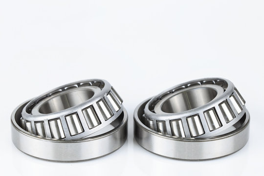 Close-up Tapered Roller bearings spare part of mechanical on the white background..