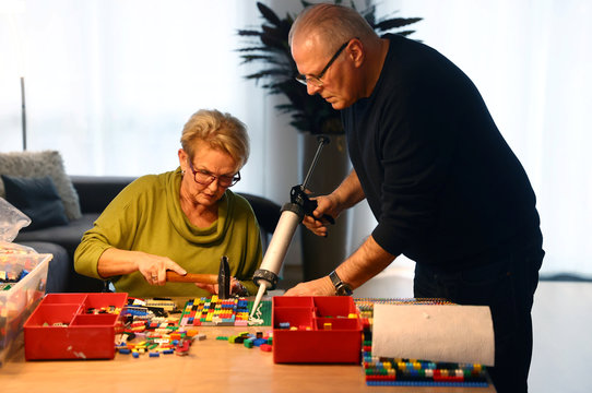 """Rita Ebel (L), nicknamed """"Lego grandma"""", and her husband Wolfgang build a wheelchair ramp from donated Lego bricks in the living room of their flat in Hanau"""