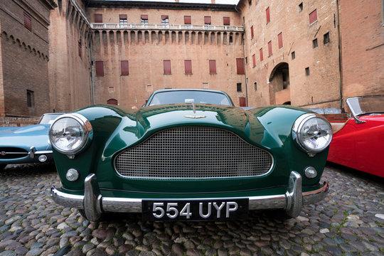 Aston Martin classic car on display in front of the Estense Castle, Ferrara, Italy - March 25, 2017