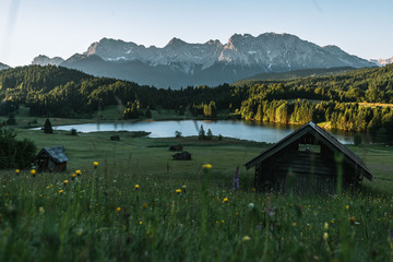 Serene sunrise over lake Geroldsee with the Karwendel mountains in the background
