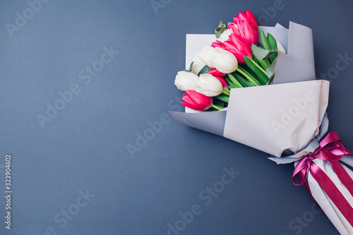 Spring flowers. Women's day background. Bouquet of white and ping tulips. Present gift for Mother's day. Space