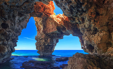 Caves by the sea in a beautiful place, rocks in the sea