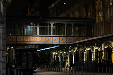 Foto auf Leinwand Bahnhof Street photography at night in St Lazare station - Paris, France