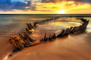 Photo sur Toile Naufrage Ship wreck on the Rossbeigh beach in Co. Kerry at sunset, Ireland