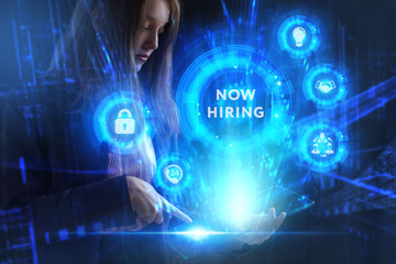 Business, Technology, Internet and network concept. Young businessman working on a virtual screen of the future and sees the inscription: Now hiring
