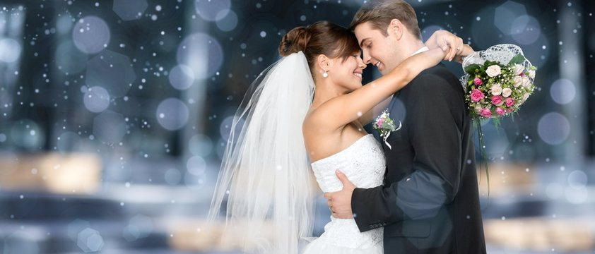 Happy just married young couple on bokeh background