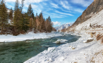 Winter landscape. Chuya River in Altai on a sunny day. Russia