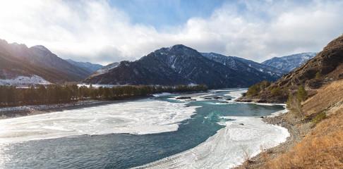 Winter landscape. Katun river in Altai on a sunny day. Russia