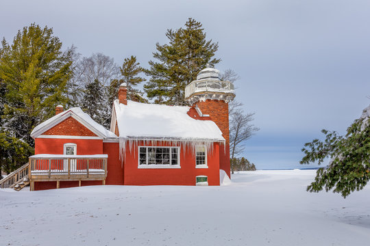 Red Lighthouse Under Deep Snow