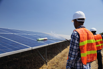 Employees or technicians to clean solar cells in a solar plant.