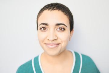 Portrait of beautiful girl smiling at camera