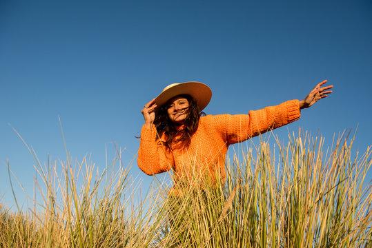 Happy female tourist smiles in the wind