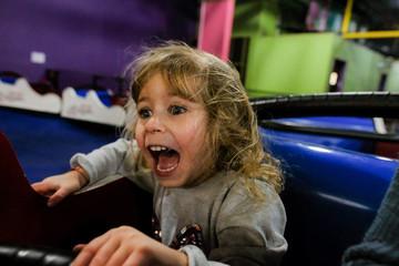 little girl screaming on amusement park ride