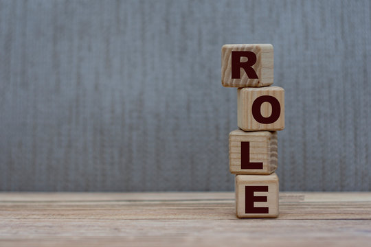concept word role on wooden cubes on a gray background