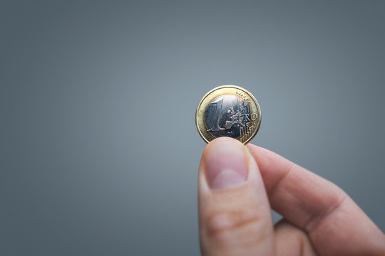 Hand held 1 Euro coin