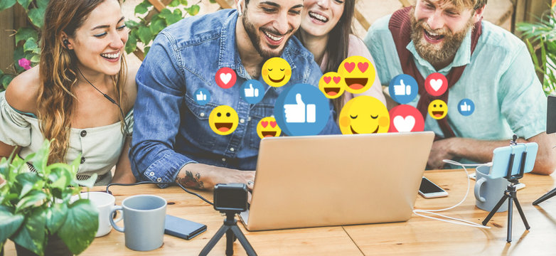 Young people streaming online using laptop, smartphone and action cameras - Millennial friends having fun with new technology trends - Social network, vlogging and tech concept