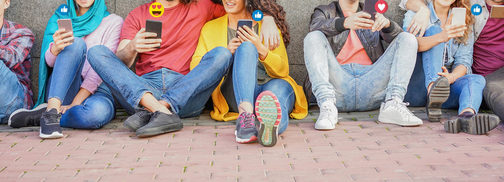 Young friends using smart mobile phones - Teenagers addiction to new technology trends - Concept of youth, tech, social and friendship - Focus on hands