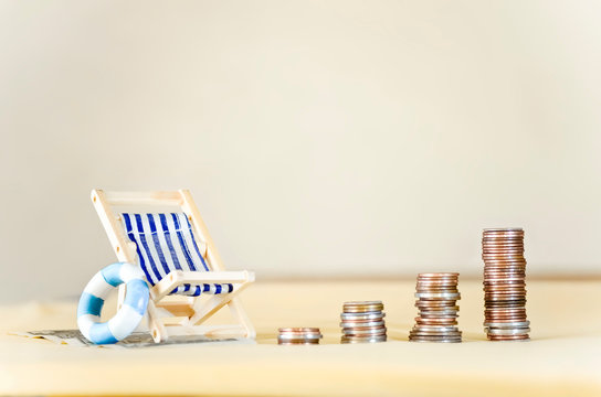 Miniature Beach Chair with Increasing Stacks of Coins