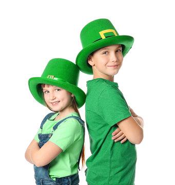 Funny little children on white background. St. Patrick's Day celebration