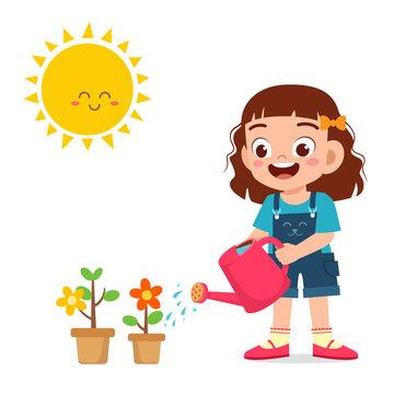 happy cute little kid girl watering flower