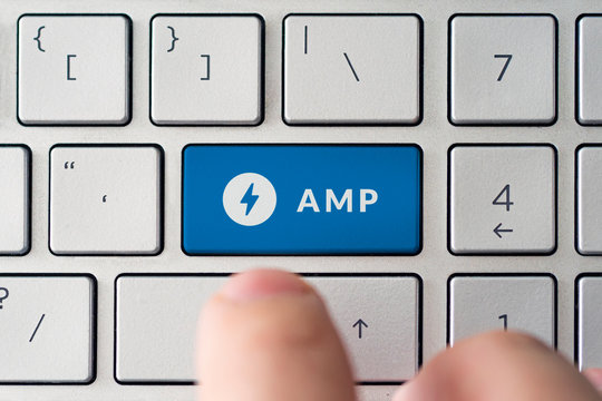 The male presses a black button on the keyboard with the amp logo.