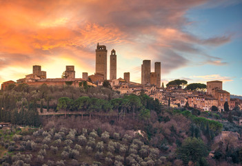 San Gimignano town skyline and medieval towers at sunset. Tuscany, Italy