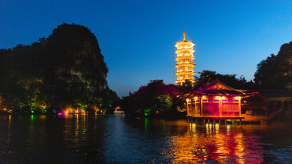 Fotorolgordijn Guilin Beautiful landscape and view of a Pagoda during a boat cruise in Guilin, China