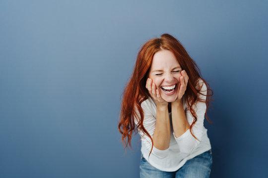 Fun young woman enjoying a good joke