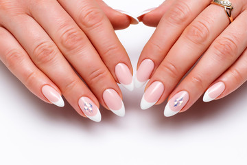 Poster de jardin Manicure Wedding manicure. French classic manicure on long sharp nails with crystals close up on a white background