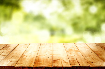Desk of free space and blurred spring landscape