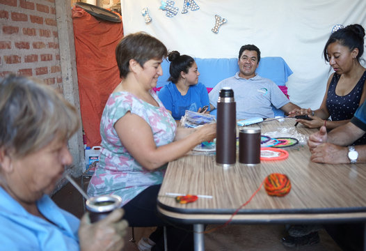 Alberto Valenzuela smiles while spending time with his family, in Anelo