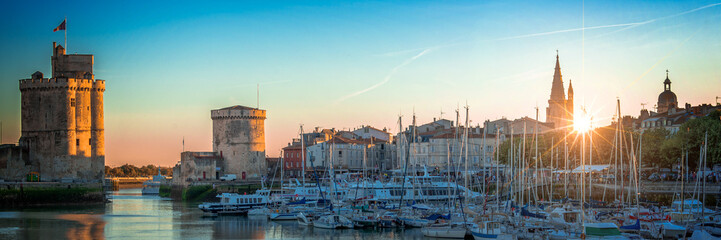 Wall Mural - Panorama of the old harbor of La Rochelle, France at sunset