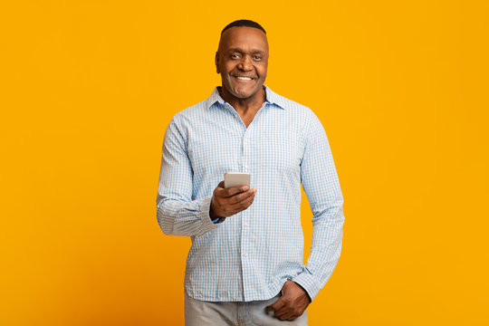 Mature african american man networking on cellphone