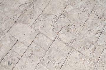 Fototapete - Gray concrete road pavement with decorative relief