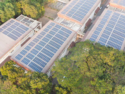 Aerial view photo of solar panels.solar panels absorb sunlight to generate electricity. Solar Power Station renewable energy on rooftop