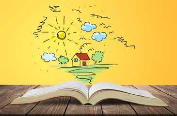 Wall Mural - Open book with drawings on old wooden table