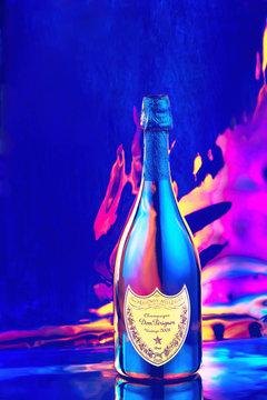 Bottle of Champagne Dom Perignon Vintage 2008 in disco neon lights