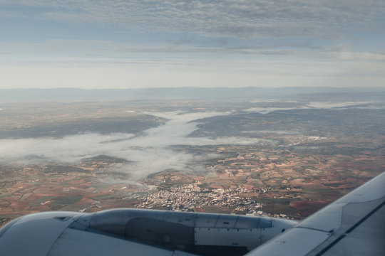 Aerial view of a city from the aircraft window