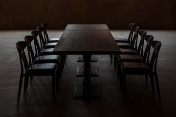 Dark board room. Stressful meeting concept.