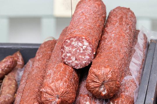 Artisanal charcuterie salami at a farmers market.