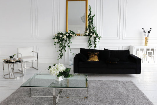 fireplace with a mirror in a gold frame in the living room of a luxury apartment