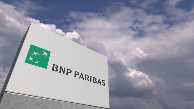 Logo of BNP PARIBAS on a stand against cloudy sky, editorial 3D rendering