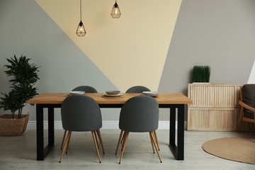 Modern wooden dining table in room interior