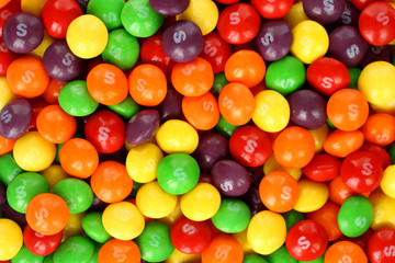 Skittles multicolored fruit candies background