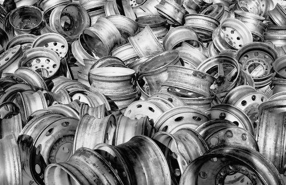 pile of aluminum  wheel rims