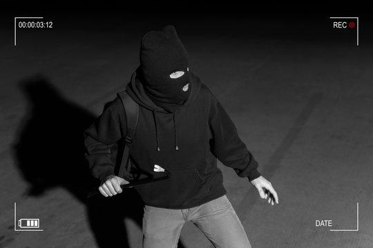 Robber Prepared For Crime In Dark Alley