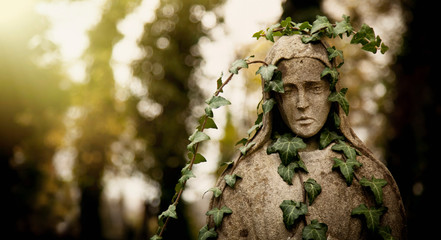 Fototapete - Virgin Mary in ivy. Fragment of ancient statue. Religion, faith, Christianity concept. Horizontal image.