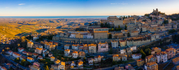 Beautiful aerial scenic view of Guaita fortress on Monte Titano with San Marino city in background at sunrise. Beautiful country of San Marino historical center. Castle on top of the hill. Wall mural